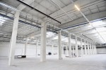 Interior detail with an empty industrial storage depot with ceiling heating system